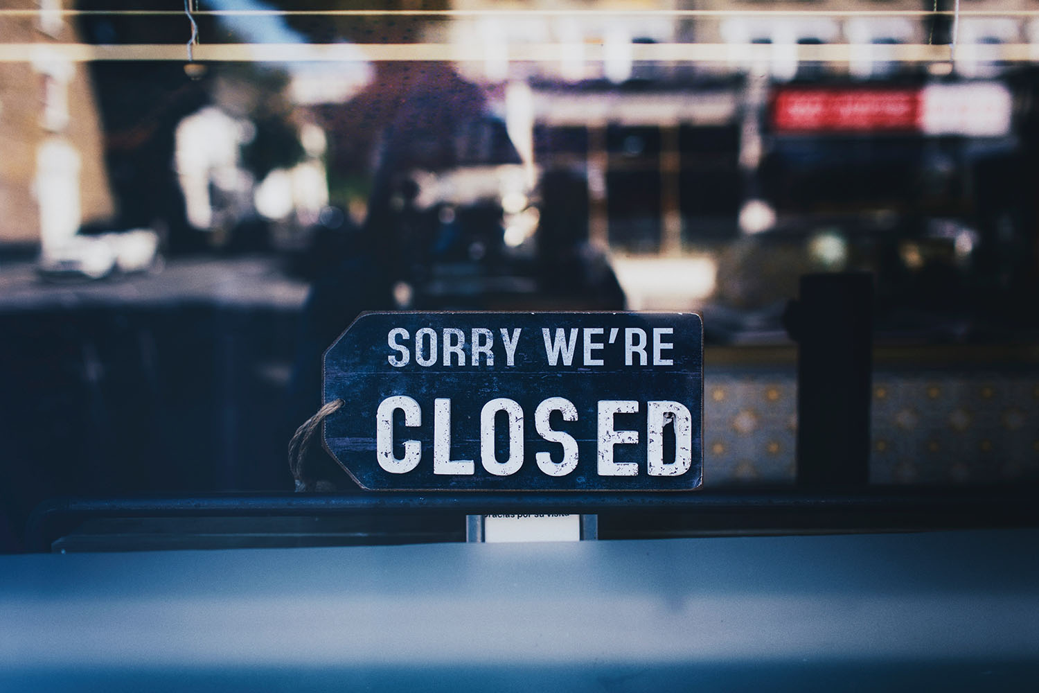 close-up-photo-of-sorry-we-re-closed-sign-on-glass-window-2467649